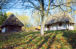 Country wooden hut and autumn garden grass near Stock Photos
