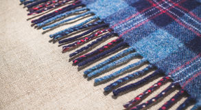 Country woolen fabric. Fringe of an old Scottish warm blanket Stock Photos