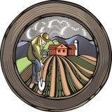 Countrylife and Farming Illustration in Woodcut Style. Illustration in retro woodcut style of a farmer, digging the land Stock Photography