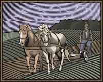 Countrylife and Farming Illustration in Woodcut Style. Illustration in retro woodcut style of a farmer, ploughing the land Royalty Free Stock Images