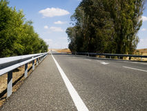 Countryroad on a bright day. Bright light day on road at spanish countryside Stock Image