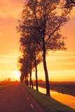 Countryroad in Netherlands by twilight Stock Photography