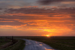 Countryroad at sunrise Stock Photography