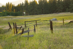 Countryside. A picture of a broken wooden fence in a countryside field Royalty Free Stock Photos