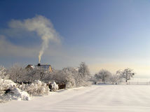 Countryside. Still countryside, house at the snow-covered field Stock Image