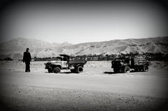 Countryside in Afghanistan. A man walking around damaged trucks in Logar Province, Afghanistan Royalty Free Stock Photography