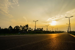 Countryside asphalt highway at summer sunset Royalty Free Stock Images