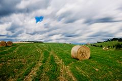 Countryside with bales of hay Stock Photos