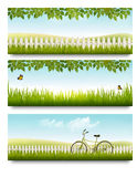 Countryside banners with grass, white fence and leaves. Stock Images