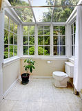 Countryside bathroom with glass wall and ceiling Royalty Free Stock Images