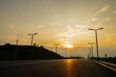Countryside blacktop in summer sunset Royalty Free Stock Photo