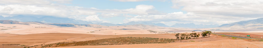Countryside between Bot River and Caledon. Panoramic view of the countryside between Bot River and Caledon in the Overberg region of the Western Cape Province of Stock Photos