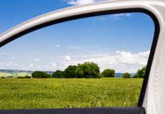 Countryside through a car window Royalty Free Stock Image