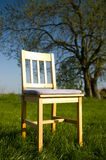 Countryside with chair. Countryside with simple wooden chair Royalty Free Stock Images