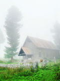 Countryside church in fog Royalty Free Stock Images