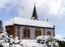 Countryside church over the snow, winter day Royalty Free Stock Image