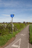Countryside cycle lane. Cycle lane and footpath sign at the beginning of a roadside path in the countryside Stock Photos