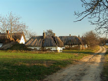 Countryside dirt road. And traditional wine cellar with thatced roof form Buzsak (Hungary Stock Photography
