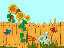 Countryside fence. Rough village fence with flowers and butterflies Stock Image
