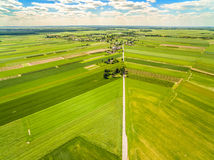 Countryside and field seen from the bird`s eye view. Crop fields stretching to the horizon. Crop field photo with a dron. Fields and bats seen from the bird`s stock photography