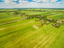 Countryside and field seen from the bird`s eye view. Crop fields stretching to the horizon. Crop field photo with a dron. Fields and bats seen from the bird`s royalty free stock images
