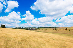 Countryside with fields on the background of blue sky Royalty Free Stock Images