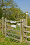 Countryside Gate. A gate in the English countryside giving clear instructions to keep dogs on a lead as well as making sure you close the gate Stock Photos