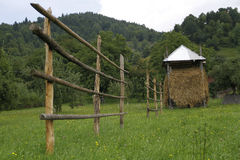 Countryside grassland. With haystack and wooden fence in Maramures, Romania Royalty Free Stock Photo