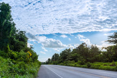 Countryside highway against blue sky and cloudy, bypass a green Royalty Free Stock Image