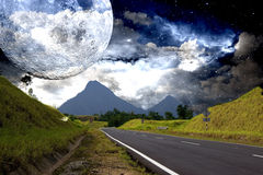 Countryside Highway with Galactic Background. Image of a highway with the moon, stars and galaxies in the background Stock Photos