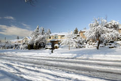 Countryside homes covered by snow Stock Images