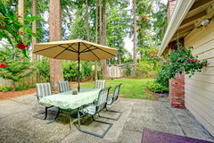 Countryside house backyard  with patio table Royalty Free Stock Image