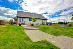 Countryside house exterior with concrete walkway Royalty Free Stock Images