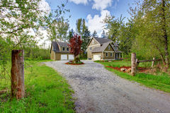 Countryside house exterior. View of entrance and gravel driveway Stock Photography