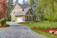 Countryside house exterior. View of entrance and gravel driveway. Countryside house exterior with garage. View of entrance and gravel driveway stock image