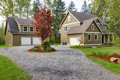 Countryside house exterior. View of entrance and gravel driveway Royalty Free Stock Images