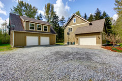 Countryside house exterior. View of entrance and gravel driveway Stock Images