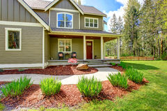 Countryside house exterior. View of entrance porch and curb appe Royalty Free Stock Images