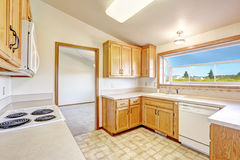 Countryside house interior. Kitchen room with vaulted ceilign an Stock Photos