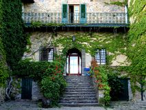 Countryside house in Italy. Tuscan old countryside house covered with green leaves in the region of Chianti , Italy . Rural typical villa with two floors and a Royalty Free Stock Photography