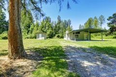 Countryside house with walkout basement and small shed Royalty Free Stock Photos