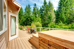 Countryside house. Walkout deck with jacuzzi Royalty Free Stock Image