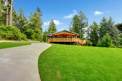 Countryside house with wooden walkout deck Royalty Free Stock Photo