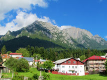 Countryside houses near rocky mountain Stock Photo