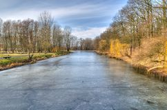 Countryside landscape with frostiness. River and trees on sunny winter day in Torun, Poland Stock Images