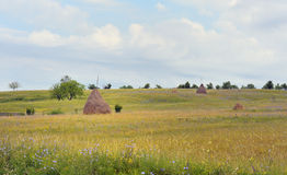 Countryside landscape with haystack Stock Image