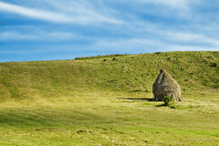 Countryside Landscape with Haystacks on a Meadow Stock Photography