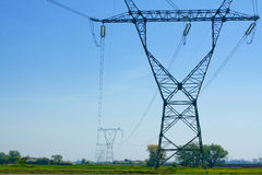 Countryside landscape with high voltage electric line Royalty Free Stock Images