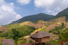 Countryside landscape mountain with wooden house. In Asia Royalty Free Stock Photography
