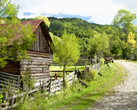 Countryside Landscape with Old Cottage and Road Royalty Free Stock Photography